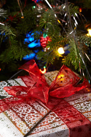 Christmas gifts under the christmas tree with a red ribbon.