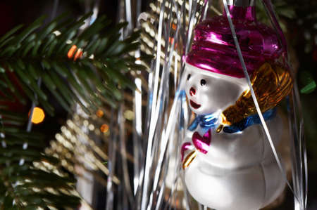 Traditional christmas decoration in close up with snowman bauble.