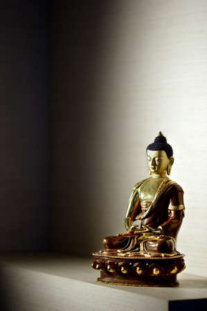 Golden and brown statue of buddha - shallow focus