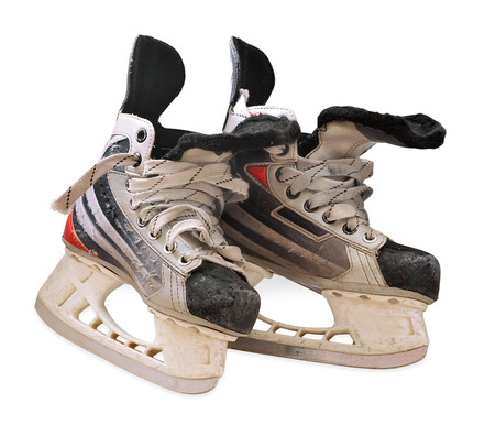 iceskates: isolated childrens hockey skates with strong traces of use Stock Photo
