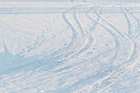 abstract traces of tires on snow photo