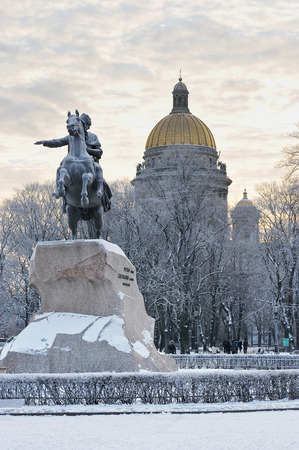 horseman: ST. PETERSBURG, RUSSIA - JANUARY 09, 2016: the monument of Peter the great - the bronze horseman and St. Isaacs Cathedral in winter, St. Petersburg, Russia