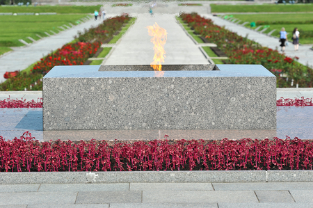 national military cemetery: eternal flame at Piskarevsky cemetery in St. Petersburg, Russia