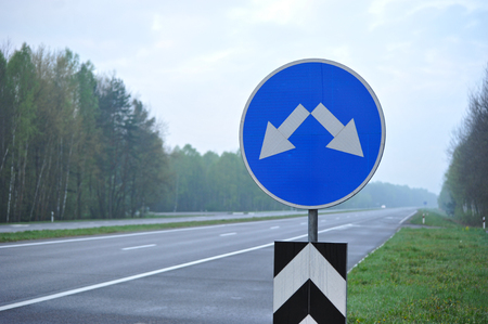 lenticular: road sign on the highway. the arrows indicate the direction of motion