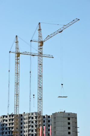 cranes: construction cranes building a house