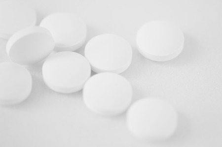 abstract background - a scattering of white tablets Stock Photo