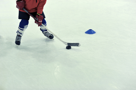 hockey player with the puck on training