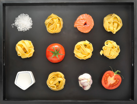 Pasta tagliatelle set over black background