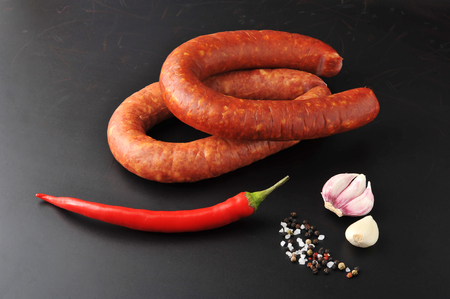 krakow sausage: Krakow sausage with red chili pepper and spices
