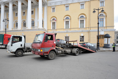 car breakdown: St.Petersburg, Russia - April 23, 2016: tow truck takes cars under the supervision of the police Editorial