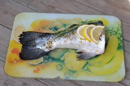 fish tail: raw fish tail salmon with lemon and rosemary