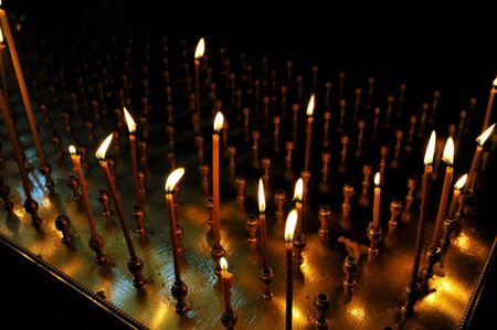 lit candle: lit candle inside of an Orthodox Church Stock Photo
