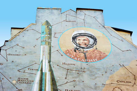 peterburg: St.-Petersburg, Russia - June 03, 2016: House wall with graffiti with a space theme and a picture of Gagarin on the Chkalovsky Prospekt Editorial