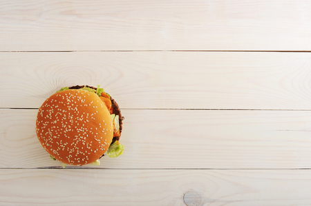 bbq hamburger with vegetables, spices on wooden white background. Top view with copy space for text menu