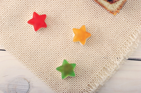 candy in the form of stars on a linen blanket on wooden background Stock Photo
