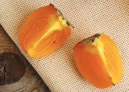 sliced orange  persimmon on canvas - the view from the top