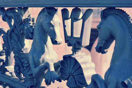 iron railings of the fence with horses on Blagoveshchensky bridge in St. Petersburg, Russia Stock Photo