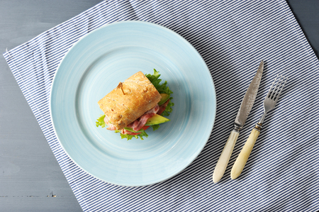 sandwich with bacon and avocado pierced with a skewer - top view Stock Photo