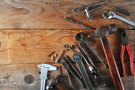 Labour day background concept - many handy working tools on wooden rustic background.  top view copy space Stock Photo