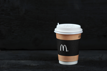 St.Petersburg, Russia - 12 August 2018: McDonald's meal on rutic black background, includes  Coffee cup