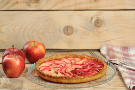 apple pie on wooden rustic background and apples
