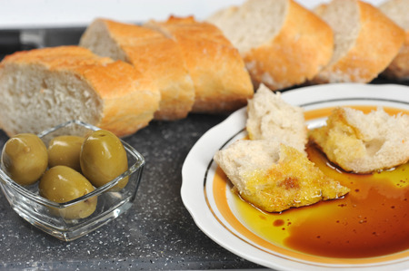pieces of baguette dipped in olive oil with balsamic vinegar - closeup