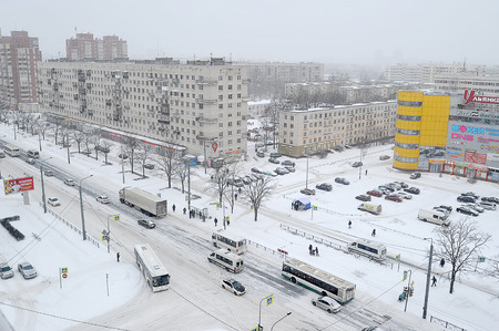 St. Petersburg, Russia-January 17, 2019: traffic on the snow-covered streets of St. Petersburg near Veteranov Avenue