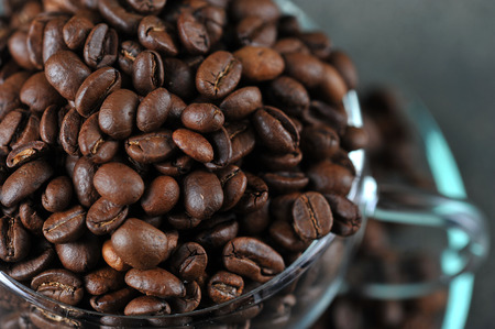 coffee beans in transparent glass Cup as a coffee background - top view 写真素材