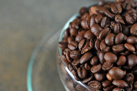 coffee beans in transparent glass Cup as a coffee background - copyspace 写真素材