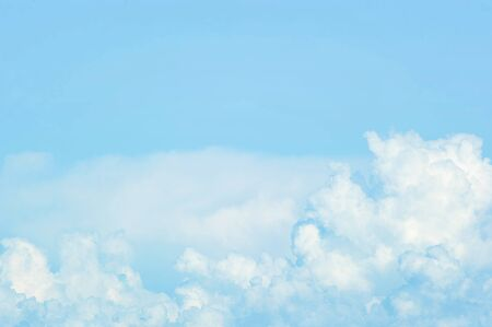 white Cumulus clouds in blue sky - abstract background of clouds