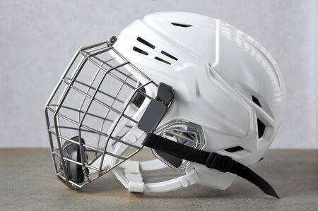 white hockey helmet with iron mask-hockey player mask side view Reklamní fotografie