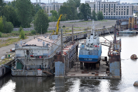 St. Petersburg, Russia, August 3, 2019: ship dock - ship repair in the dock on the Neva river in St. Petersburg