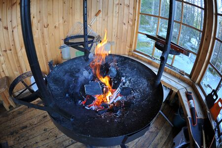 barbecue with burning coals in a wooden house Stock Photo