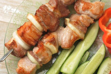 cooked pork skewer on skewers - with onions, tomatoes and bell peppers