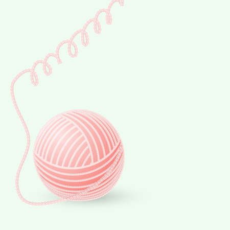 ball of woolen thread on a green background