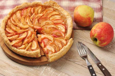 Apple pie on a plate - autoumn tart desert on wooden background