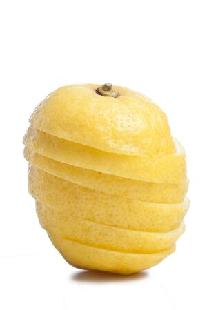 slices of lemon: Stacked slices Lemon fruit isolated on white.