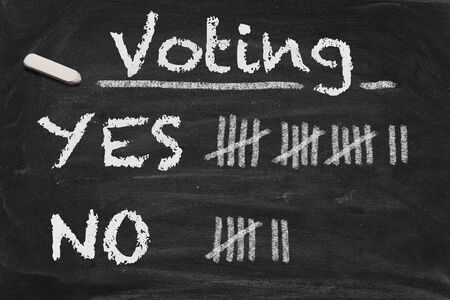 tally: High resolution black chalkboard image with voting results on tally. Conceptual image for decision or democracy themes. Stock Photo