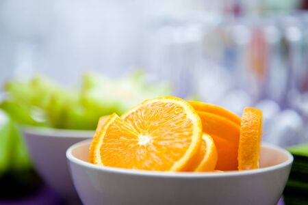 High resolution photography of some orange and carambola slices in bowls for cocktail decoration as party preperation. Shallow depth of field at orange. Copy space included. Portrait and landscape. photo