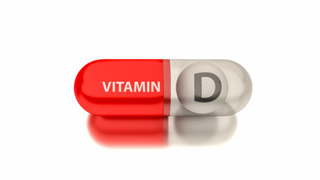 Vitamin D in red capsule. Conceptual image for health concepts.