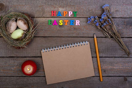 Easter background. The inscription of the wooden letters