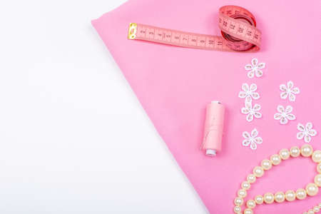 Tailoring. Sewing and needlework. Imitation jewelry on white background. Isolate, Flat Lay, Copy Space