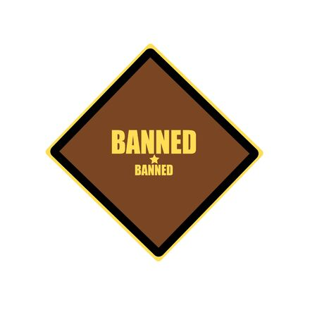 enhancing: BANNED yellow stamp text on brown background Stock Photo