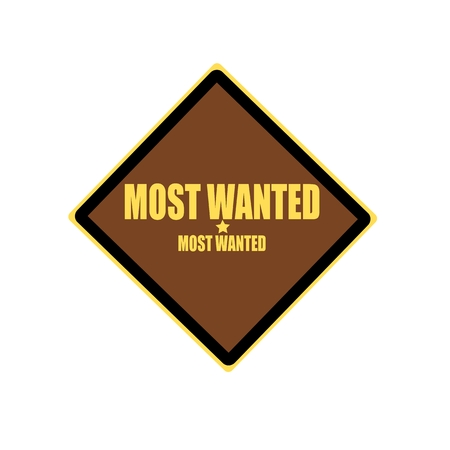 covet: Most wanted yellow stamp text on brown background Stock Photo