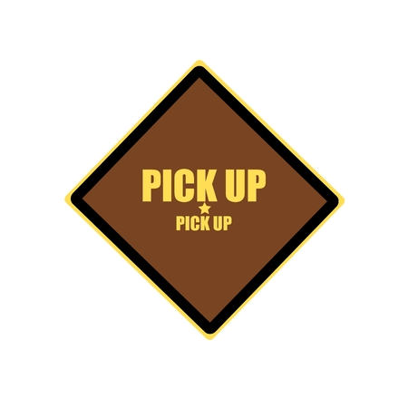 pick: Pick up yellow stamp text on brown background Stock Photo