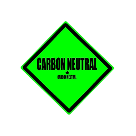 carbon neutral: CARBON NEUTRAL black stamp text on green background Stock Photo