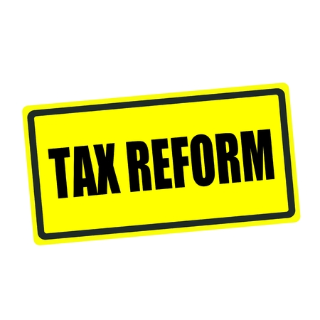 reform: Tax reform back stamp text on yellow background