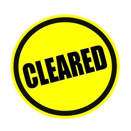 cleared: Cleared black stamp text on yellow Stock Photo