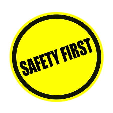 safety first: SAFETY FIRST black stamp text on yellow
