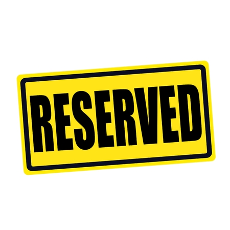 reserved seat: Reserved black stamp text on yellow Stock Photo